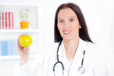 Nutritionist female Doctor holding an apple