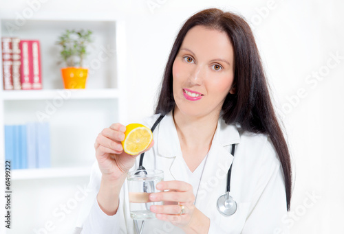 doctor holding a glass of water and lemon