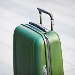 Travel  green bag at street.