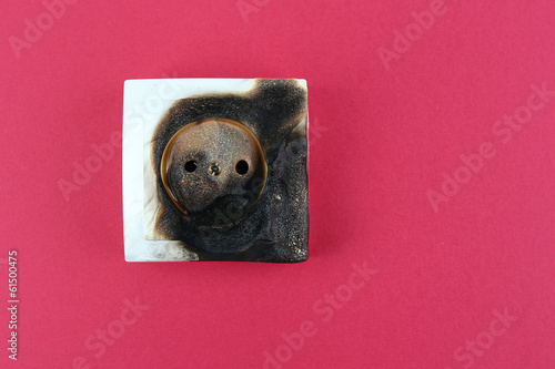 Burned plug socket close up