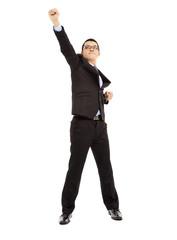full length of  energy businessman pose as superman