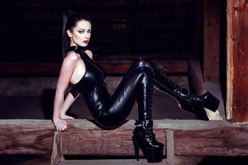 Beautiful fetish model posing on timber in high heel platform bo
