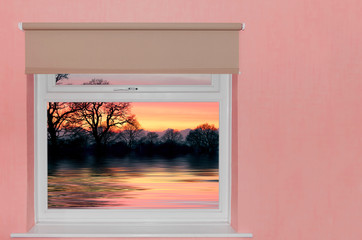 View of sunset over lake a window