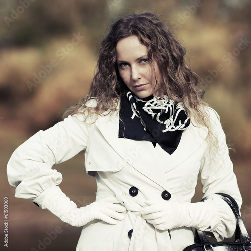 Beautiful woman with long curly hairs outdoor