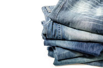stack of blue jeans over white:Clipping path included.