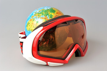 Globe behind mountain ski mask on gray
