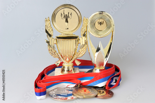 Cups and medals isolated on gray