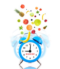 Diet concept, alarm clock ringing and fruits