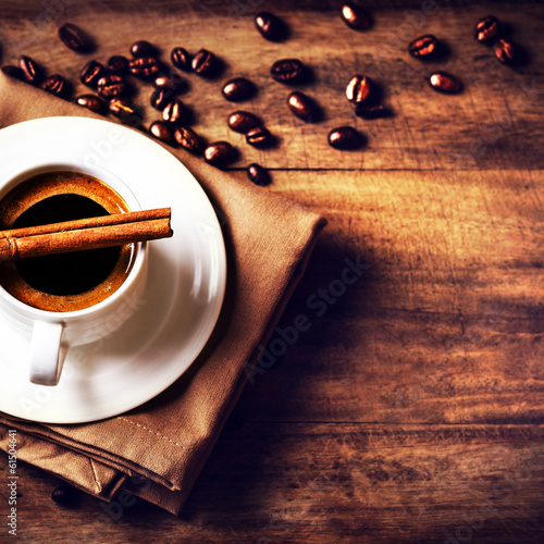 Coffee cup and roasted coffee beans  on wooden  brown background