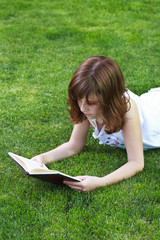 Teen.Young beautiful girl reading a book outdoor