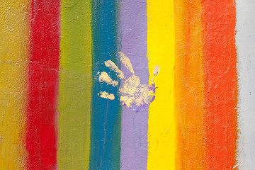 pride flag with hand print