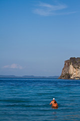 Two people swimming in the water at the beach of the Koh Ngai is
