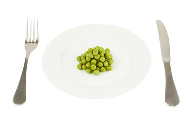 Plate with a pile of peas isolated