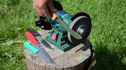 sharpening knives on electric sharpener outside