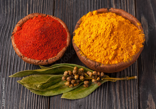 Spices curry, bay leaf and paprika. Spice over Wood.