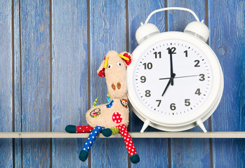 Stuffed animal giraffe and clock for bedtime
