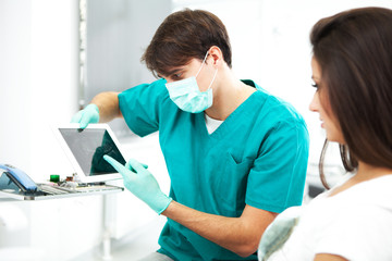 Dentist and female asistent