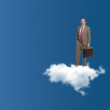 The businessman stands on a cloud