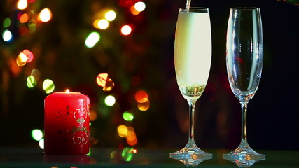 glasses with champagne and candle - romantic evening