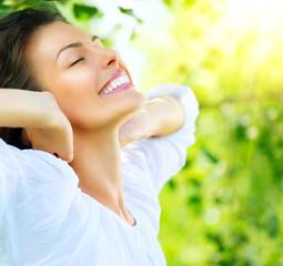 Beautiful Young Woman Outdoor. Enjoy Nature