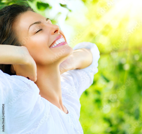 canvas print picture Beautiful Young Woman Outdoor. Enjoy Nature