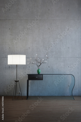 Desk with flowers and lamp