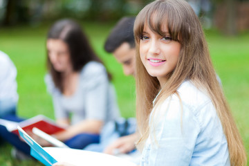 Students sitting at the park