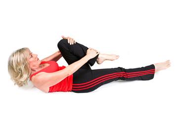 Senior Woman Does Back Exercises