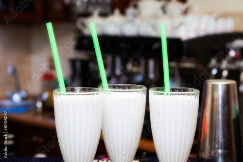 non-alcohol drink milk cocktail with straw on bar