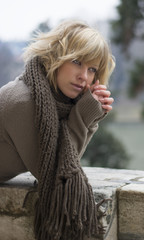 Attractive blonde young woman outdoors in winter