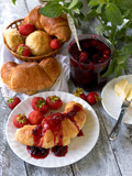 Breakfast with croissant,  ralls, berry jam and butter