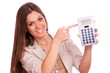 Business woman showing calculator
