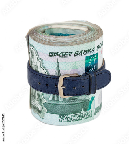 Russian rubles bills wrapped by belt isolated on white backgroun
