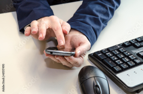 mobile in hands, mouse and keyboard
