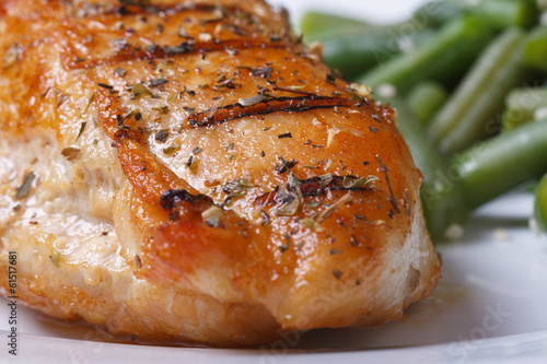 Grilled chicken breast with spices and green beans closeup