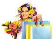 Woman with shopping bag holding flower. Isolated.