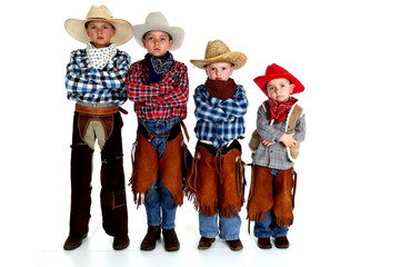 four young cowboy brothers standing with arms folded serious exp