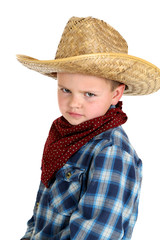 funny glraing young cowboy wearning hat and bandana