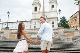 Couple holding hands on Spanish Steps, Rome, Italy