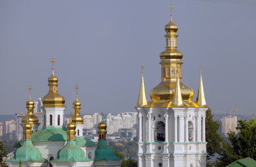 Cupolas of the church of Nativity of  Virgin and Bell tower.