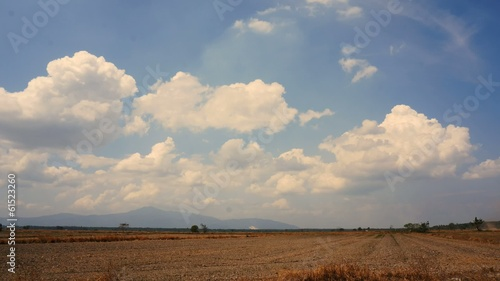 Clouds time lapse over dry grass