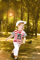 Little boy running in the park.1