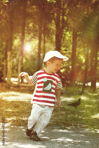 Little boy running in the park.