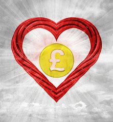 pound golden coin in red pipe shaped heart on sky grunge