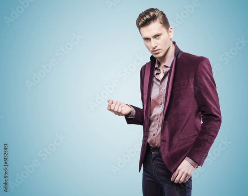 Handsome businessman over the blue background