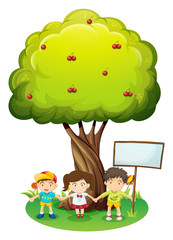 Three kids under the tree with an empty signboard