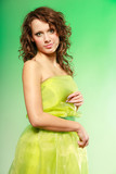 Spring or summer. Young woman girl in green dress