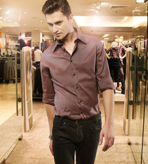 Young man in the boutique