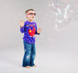 Little man playing with soap bubbles