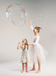 Two sisters with the large soap bubble